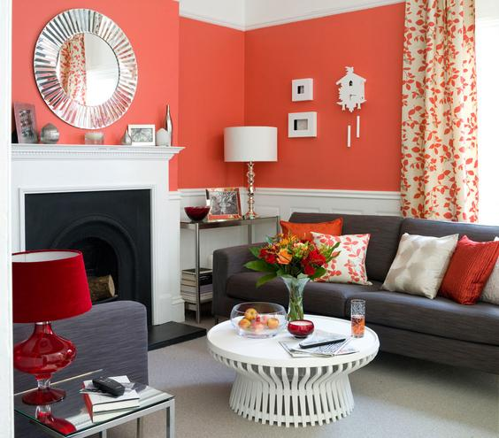 Seeing Red The secret to taming a fiery red? Balance it with pops of white. A smattering of dove white wall accents with the white fireplace, chair rail, and coffee table keep the bold color in check.