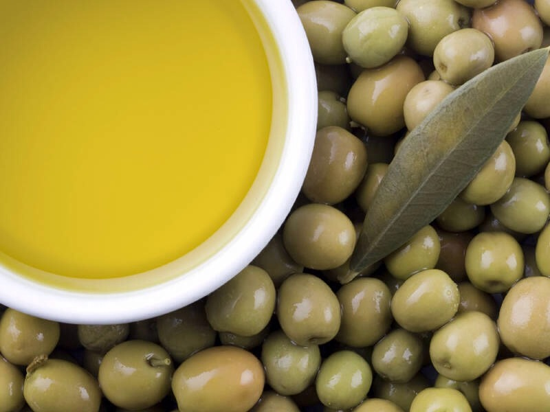 Mix about 2 spoonfuls of Grinded coffee and 1 spoonful of Olive Oil, and mix in blender until it is almost liquid like. For more quantity, add as much coffee and Olive oil seems adequate, but always having more coffee than Olive oil.