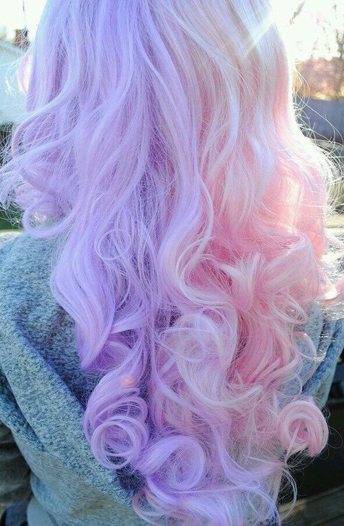 23. Curly Pastel Pink and Purple Hairstyle