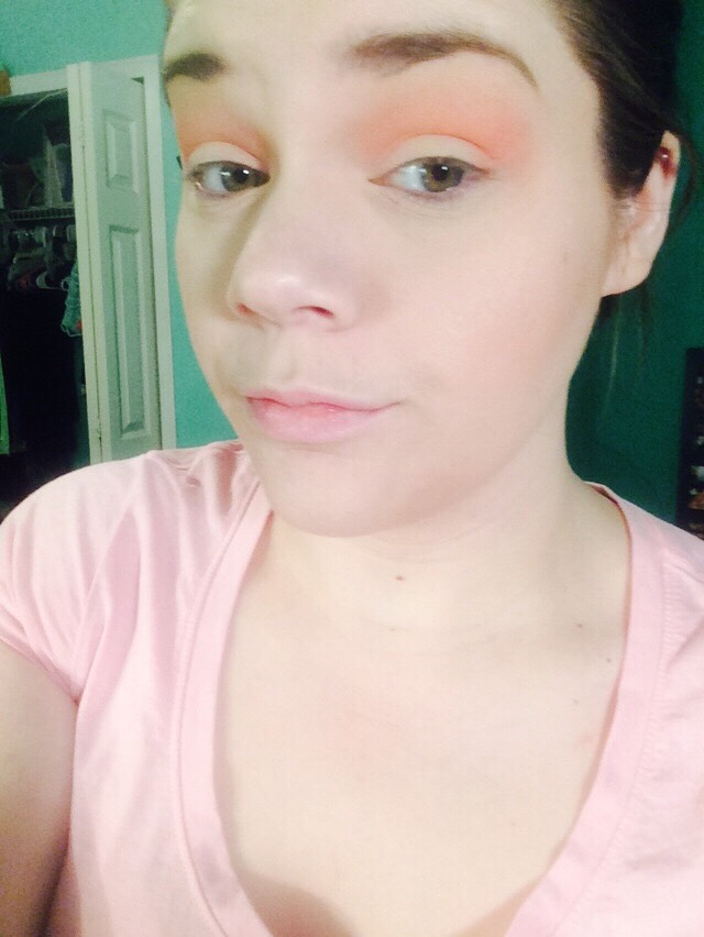Take a peachy orange eyeshadow all in the crease with a fluffy brush