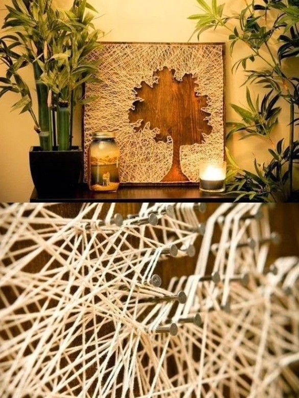 I saw this on Pinterest. I love it! All you need is a board, nails, string and a picture of the silhouette of a tree.