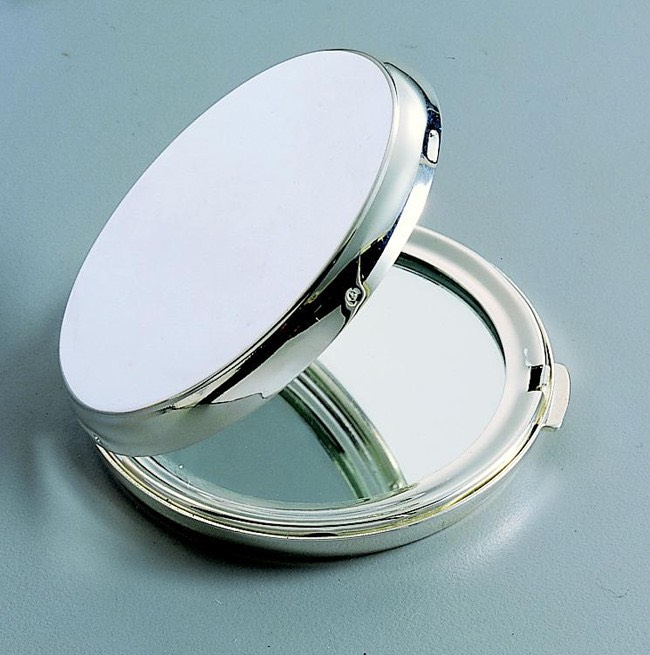A compact mirror for makeup or hair.