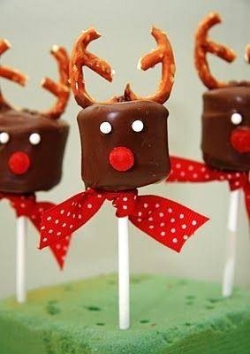 Jumbo marshmallows work the best. Skewer them on plastic sticks and dip in chocolate. While still soft add a red gumdrop for the nose (look for a smaller sized variety), split a pretzel in half for the antlers, and white tictacs or frosting can be used for the eyes. Tie ribbon to finish off the look