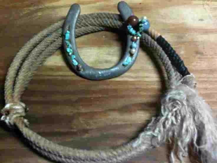 Ride em cowboy! Buy some rope and attach to wire, and to make it lighter cut a horseshoe shape shape out of cardboard and spray paint grey and embellish with turquoise beads etc