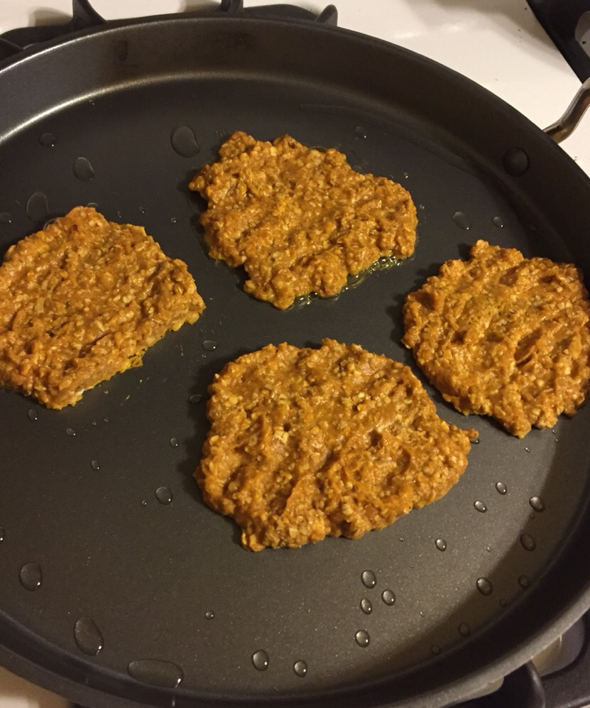 Heat a nonstick skillet over medium heat. Spray with nonstick spray. Once skillet is hot, create 4 pumpkin pancakes as best you can. They don't need to be pretty in shape. Cook aprox 3 minutes on each side.