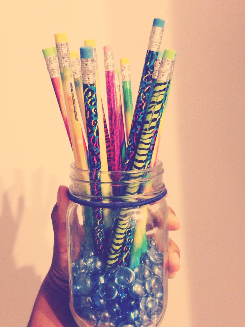 Put marbles in a jar and then put pencils or pens in the jar