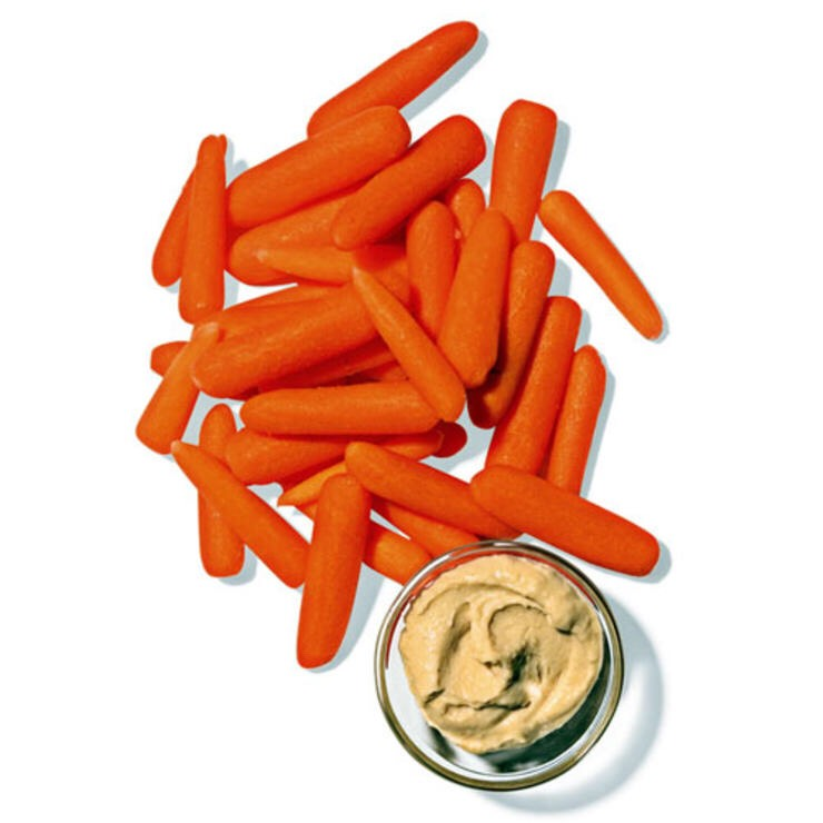 1 C BABY CARROTS WITH 2 TBSP HUMMUS The crunchy texture keeps choppers busy, and tangy hummus feeds your need for comfort food.