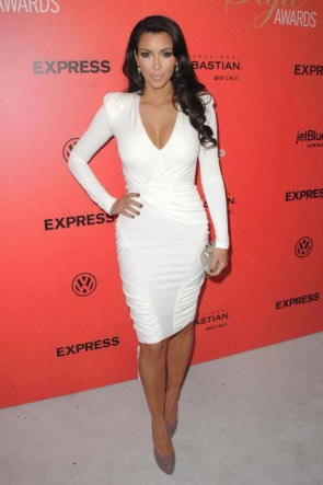 Kim recently starred in 2 broke girls wearing Something like this beautiful white dress that shows of all of her curves and really shows of her tan .