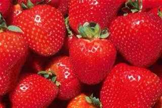 Strawberries: Teeth whitener, decreases appearance of dilated pores