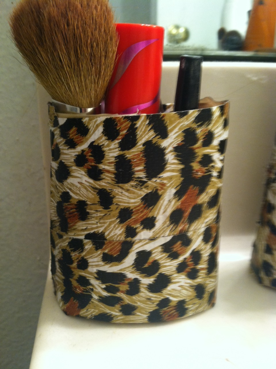 Wrap the tape around the bottle and then there you go a cute way to told your make up or your brushes
