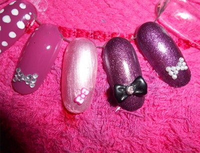 You can add acrylic bow, fimo bow, bow made up of baby pearls (follow same steps as rhinestones ones) or you can use bow shaped nail stickers and decals.