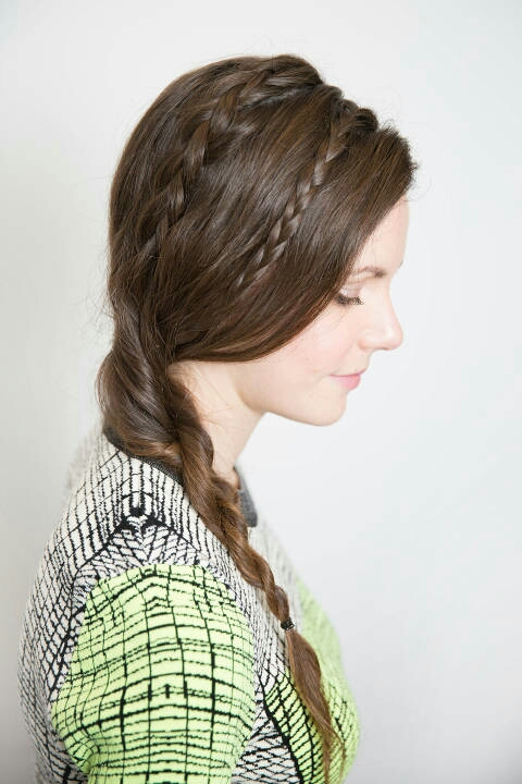 With your hair down and over to the right, choose a small section of hair an inch back from your hairline and three-strand braid it. Secure it with a hair tie. Next, an inch back from the first braid, create a French braid using larger sections and secure with an elastic band.