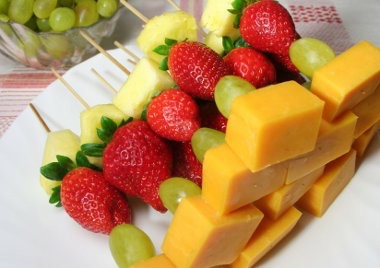 Let your child pick out what fruit they want to add also use cookie cutters to make the fruit into fun shapes.