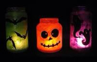 All those glass jars in your recycling can can be used to create adorable Halloween decorations, simply paint or stencil jars, place a tea light candle in the jar and you have inexpensive Halloween decorations you can reuse