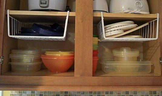 7. Hanging Shelf Dividers Hanging shelf dividers are also useful in taking advantage of empty space. I love this idea for smaller and lighter items, such as tupperware lids or plastic plates.
