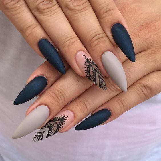 Matted black and beige pointed tipswith a translucent (clear) and black deign on the ring finger