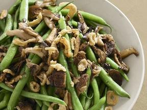 Directions Blanch green beans in boiling water until just cooked. (We like ours a little crunchy.) Meanwhile, saute sliced mushrooms in butter over medium-high heat until golden, then toss with the drained, blanched beans and some salt and pepper. Top with French-fried onions.