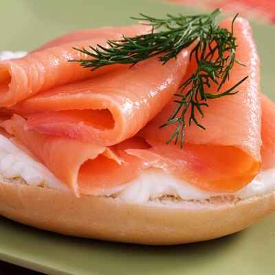 Smoked Salmon on a Bagel  Top half of a small bagel with one ounce of smoked salmon for a savory treat!