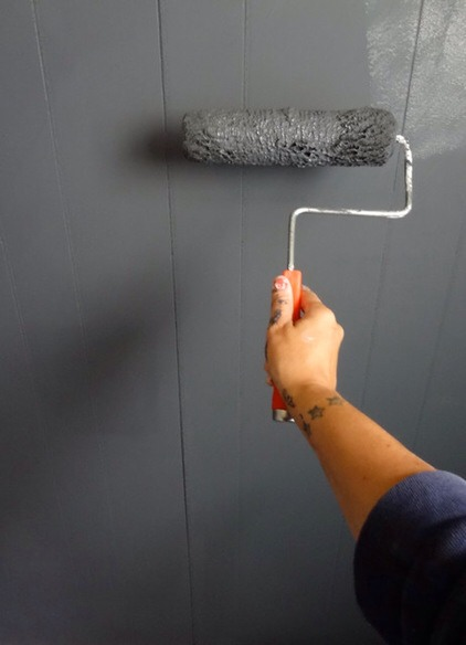 Block the sides with paints tape, mix chalkboard paint well and apply two coats to the wall.