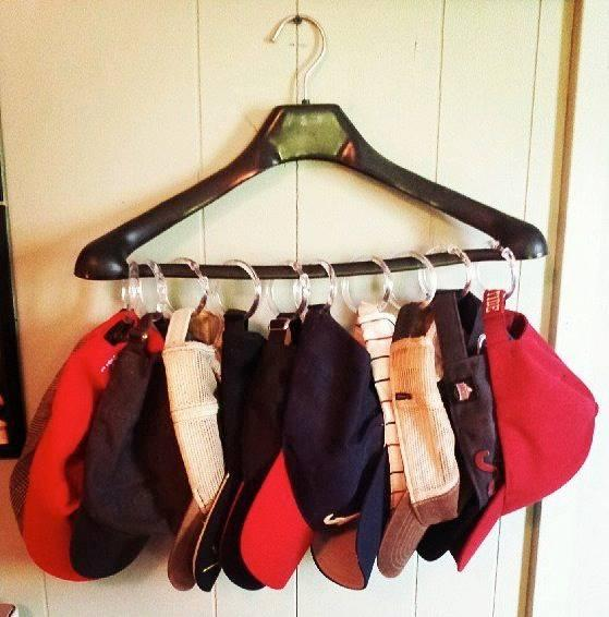 Shower hooks to a hanger to hold hats, ties, purses. etc.