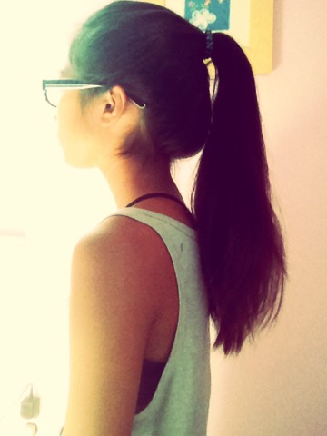 This first ponytail is going to give your ponytail an extra poof First put your hair in a pony tail