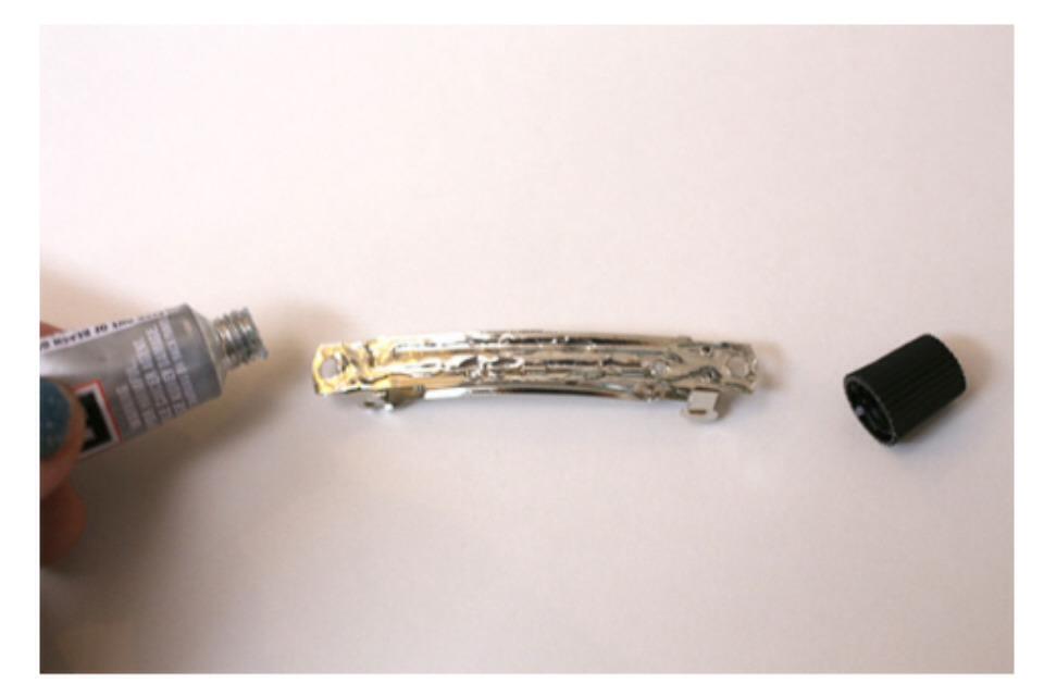 (3) Place some E6000 glue onto the barrette backing.