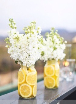 Mason jar Lemons Water Flowers of choice Maybe pink flowers and lime?