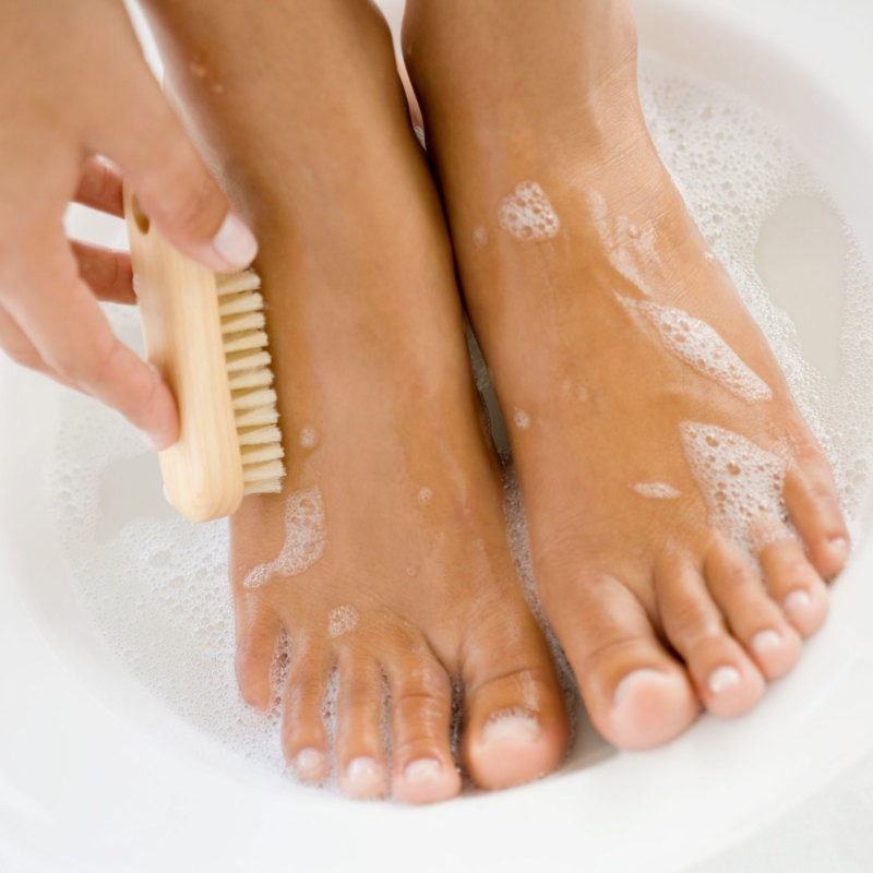While showering, gently exfoliate feet with a scrubby brush or even a washcloth.
