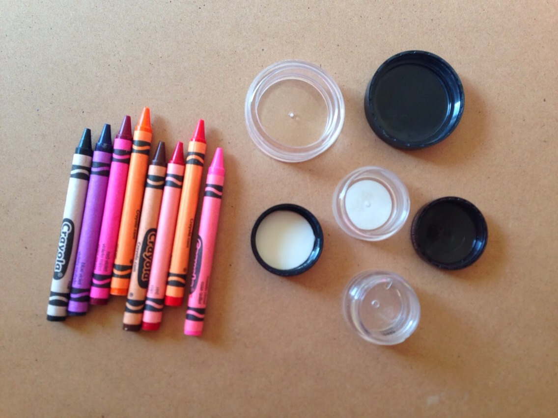 So you will need coconut oil, CRAYOLA crayons, some containers, a pot and a small jar. Must be Crayola. For our containers we just used these guys, they once held a variety of powders but, have all been used up. So we cleaned 'em up real nice and are re-using them! So here's what you do.