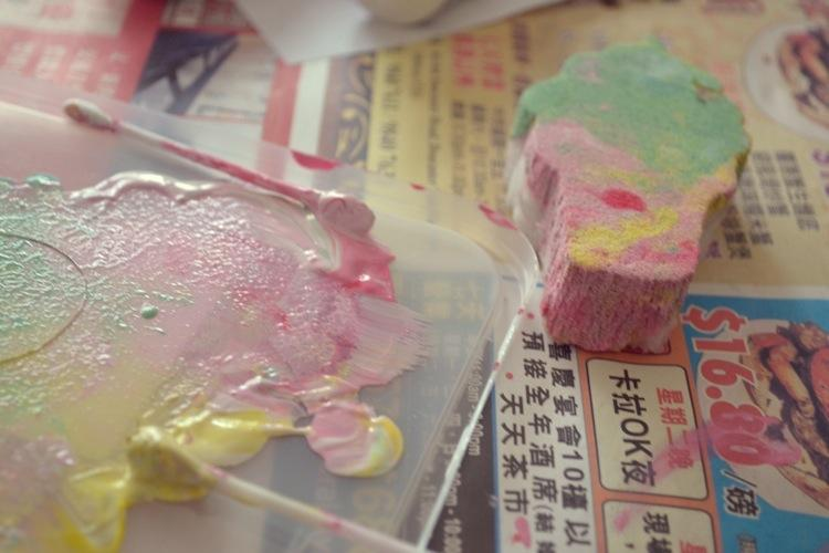 Press the foam stamp into the paint tray, making sure the paint is evenly spread. The colours will keep developing as you keep restamping. Remix or add new colours as desired. I had one tray with yellow, pink and mint and another tray with lilac, blue and yellow.