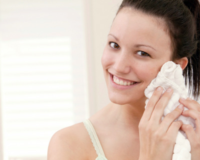 Remove product with warm wet washcloth. Cold water will make this a messy, difficult process, so make sure it's warm.