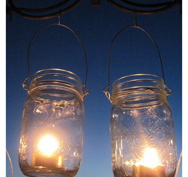 MASON JAR LANTERNS: Nothing is better than sitting under candlelight outside in the dark. Get some candles and put them in the jars. You get a romantic candle light.