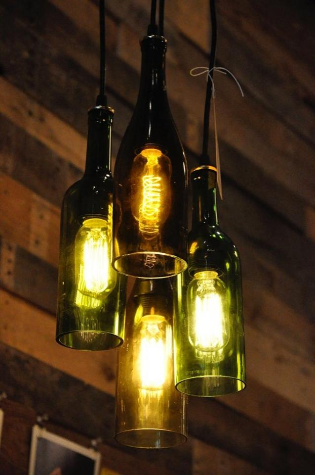 A Classy Chandelier Whether your undertake a DIY project or purchase from the pros, chandeliers made from recycled wine bottles are a lovely addition to any dining room.