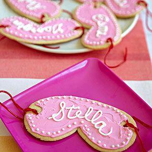 cute cookies in a shape of a mask with there name on it for them to it while being pampered