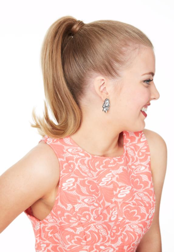 2. Use a flat iron to flip the bottom of your pony out, creating a retro style.