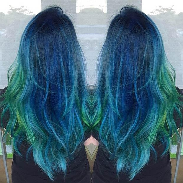 DARK BLUE HAIR + GREEN TIPS: Check out this fabulous blend of blues and greens. The placement of green highlights is amazing!