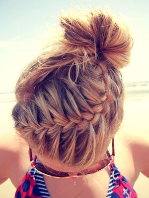 ~French braid~  Like a normal three stranded braid only adding hair to each side each time.
