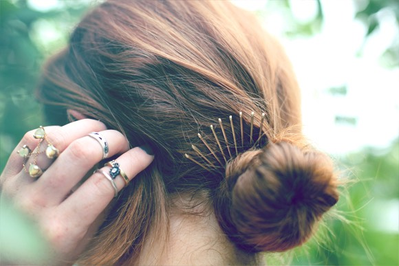 secure your bun with a hair band then take 9 bobby pins and upward so it's facing up and put it in the bun to secure the bun even more