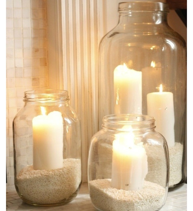 OUTDOOR LIGHTING: All you need is a mason jar, candle, some rice or maybe beach sand.