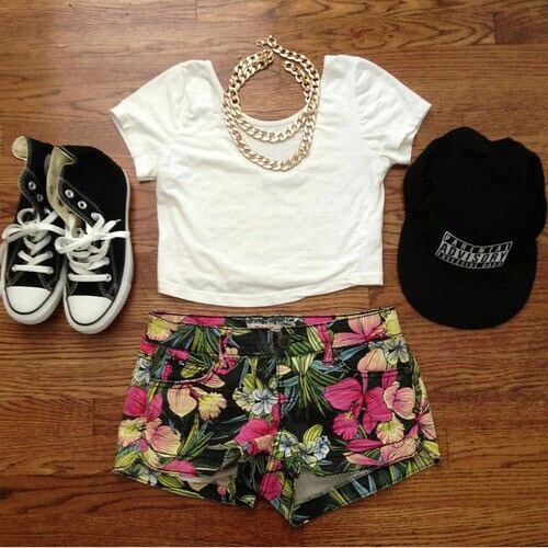 20. Not into panama hats, fedoras, or floppy hats? Pair a cheeky fitted or baseball hat with a crop top, a statement necklace, and fun shorts. This is the coolest look ever.