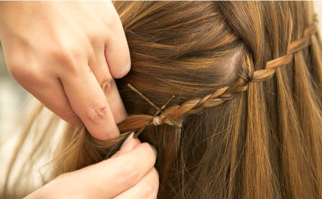 Pull back your hair and pin the braid underneath by making and X with 2 bobby pins