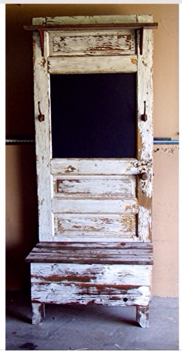 Even old doors with windows make a great chalkboard. Add hooks to hang trinkets, keys, and or coats.