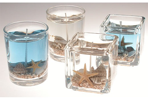 2. Seashells by the Seashore: Buy a glass vase and fill the bottom with sand and pebbles. Throw in the occasional starfish or seashell and place a floating candle on top.