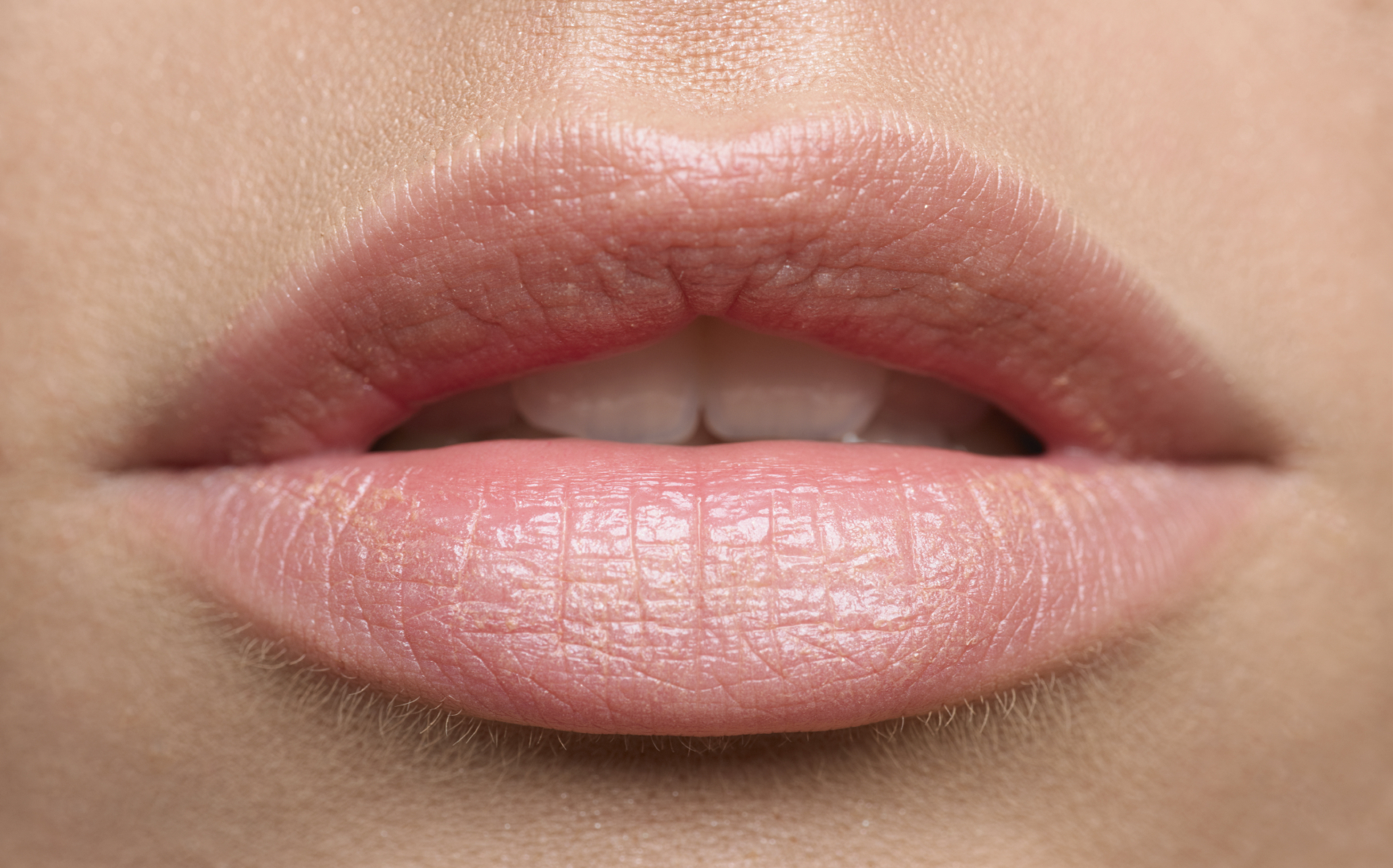 run the Vaseline over your lips every night if they are dry/cracked