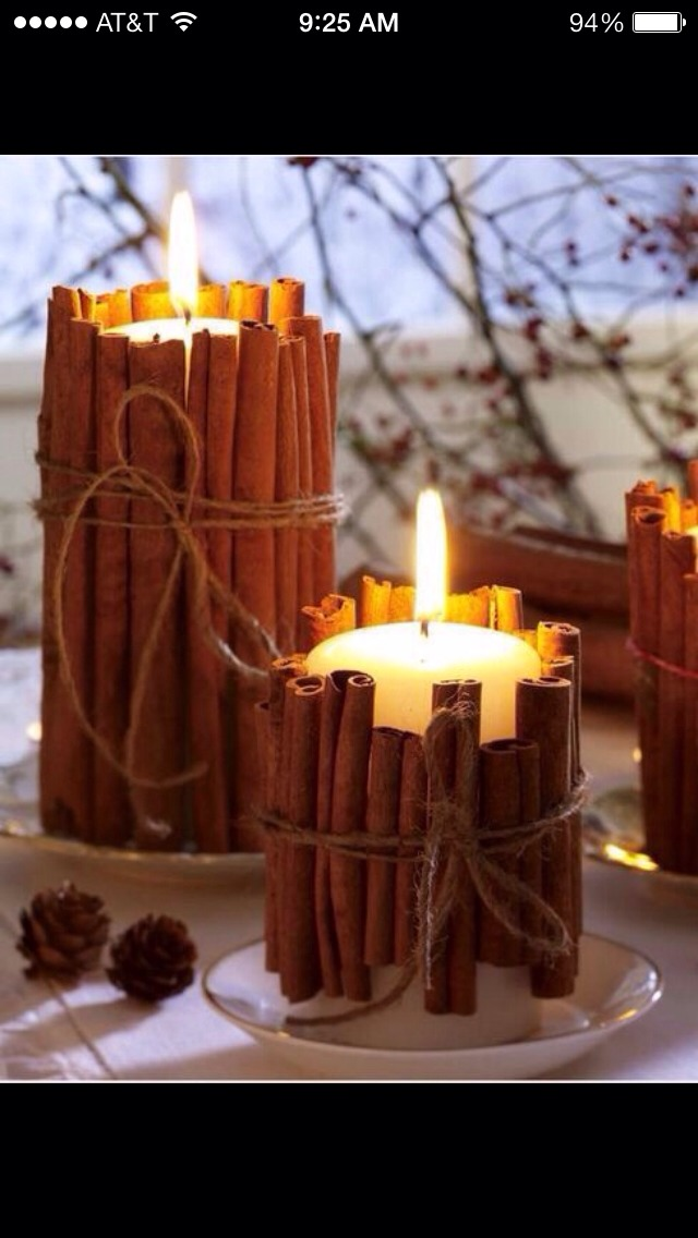 Decorate a pillar candle with cinnamon sticks to dress up a plain candle as well as infuse the warm smell of cinnamon throughout your house. The heat works to spread the cinnamon. Tie with a string and tada!