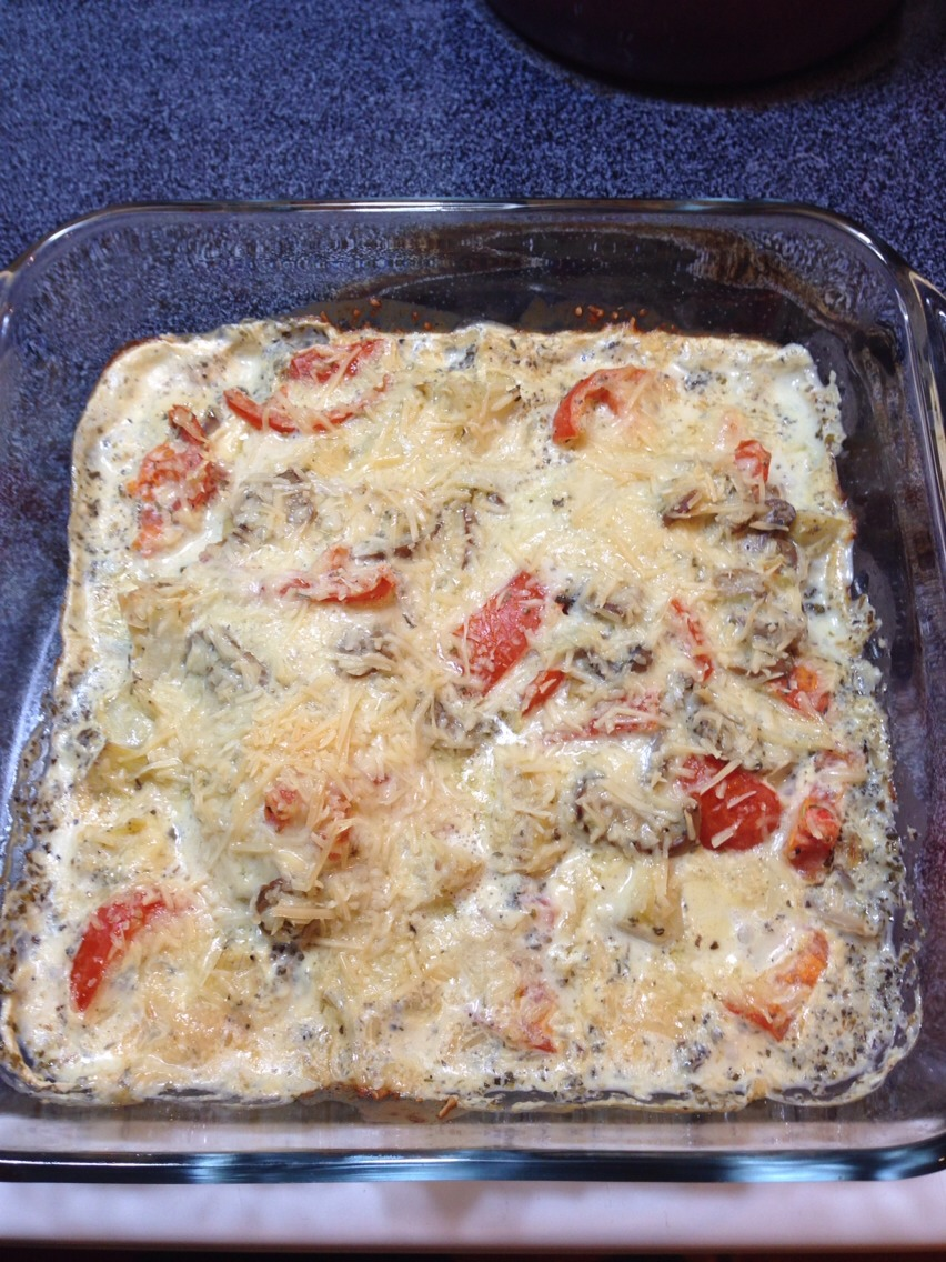 2 chicken breast 1/4 cup chicken bullion 8oz cream cheese 1 teaspoon Italian seasoning 1 tomato Small jar of artichoke  Small can of mushrooms  Mix bullion and cream cheese until smooth, chop of veggies add to mixture along with seasoning. Bake at 375 for about 35 minutes!  It's delicious!