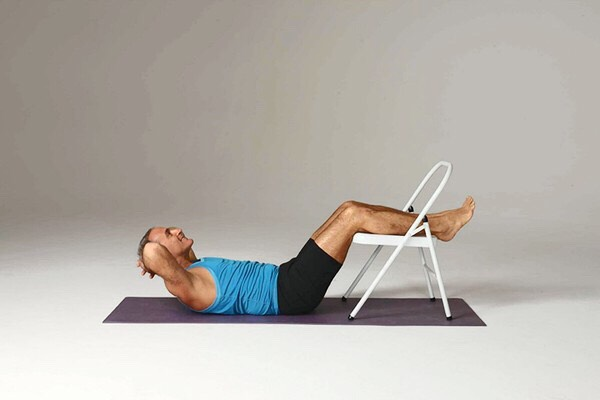 Elevated crunches Sets: 3 Reps: 15