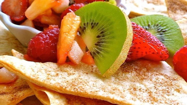 2 kiwis, peeled and diced  2 Golden Delicious apples - peeled, cored and diced  8 ounces raspberries  1 pound strawberries  2 tablespoons white sugar  1 tablespoon brown sugar  3 tablespoons fruit preserves, any flavor  10 (10 inch) flour tortillas