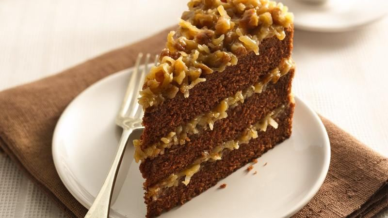 Ingredients:  *1/2 cup water *4(1 ounce) squares German sweet chocolate *1 cup butter, softened *2 cups white sugar *4 egg yolks *1 tsp vanilla extract *1 cup buttermilk *2 1/2 cups cake flour *1 tsp baking soda *1/2 tsp salt *4 egg whites