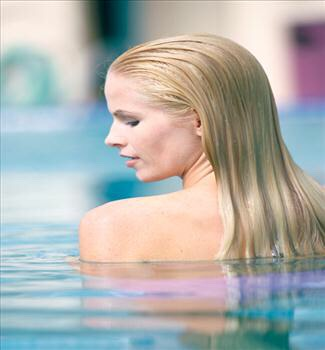 5. Protect your hair from chlorine in the pool by completely wetting your hair and saturating it in conditioner, leaving it wet. Your hair will soak up the chlorine-free water and conditioner instead of the pool water, which will prevent the damage and color turning that chlorine can do.